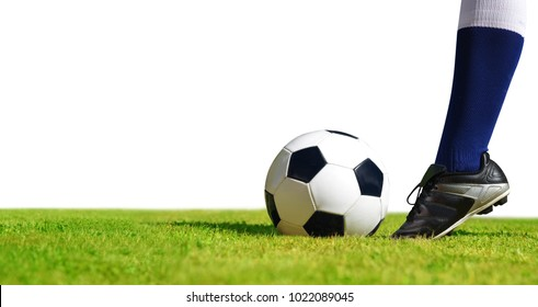 Soccer ball with feet player on the football field on white background.