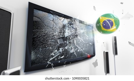 Soccer ball with the flag of Brazil flying through a shattering tv screen.(3D rendering series)