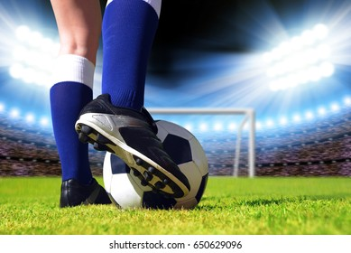 Soccer ball and foot of football player.