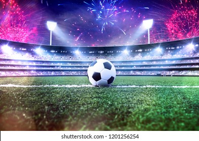 Soccer ball / football on the field of stadium with light and fireworks