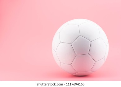 soccer ball or football on pink background