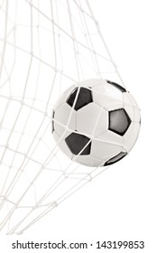 Soccer ball in a goal net isolated on white background