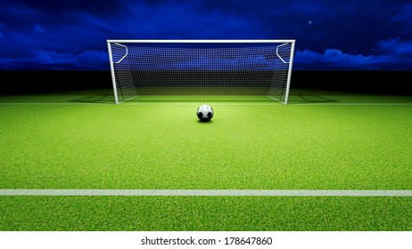 Soccer ball and goal on the football field at night sky.