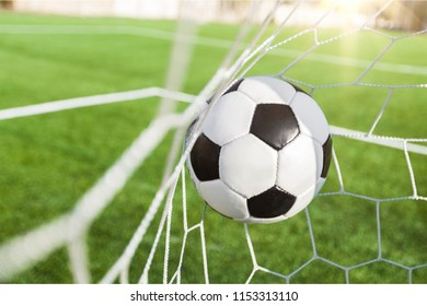 Soccer ball in goal, sport concept