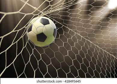 soccer ball in goal with spotlight