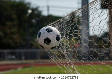 soccer ball in goal, winner concept