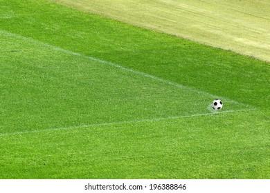 Soccer ball with green grass field.