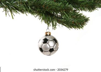 A soccer ball hanging from a Christmas tree