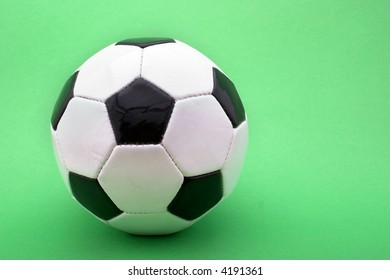 soccer ball isolated against a green background