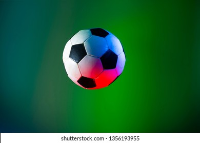 soccer ball isolated on green