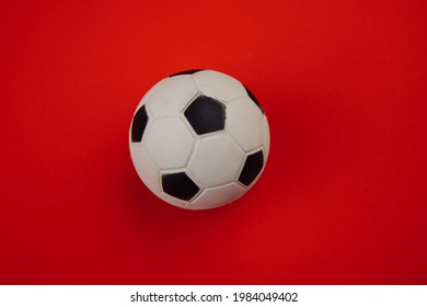 Soccer ball isolated on red