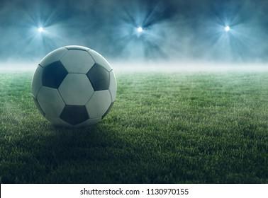 Soccer ball lays in flood light (3D Rendering)