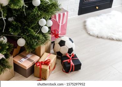 soccer ball near christmas tree