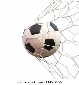 soccer ball in net on white