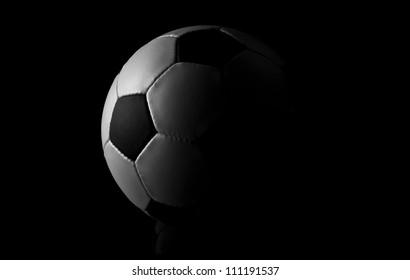 soccer ball on black background