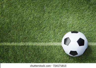 Soccer ball on field with line