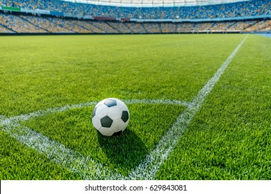 soccer ball on grass in corner kick position on soccer field stadium