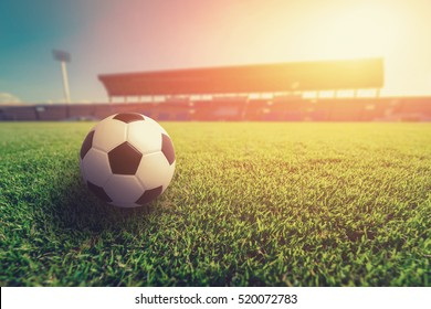 Soccer ball on grass in soccer stadium.