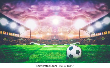 Soccer Ball On Green Field of football stadium for background