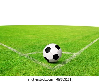 Soccer ball on green grass with copy space on the background.