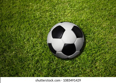 Soccer ball on meadow