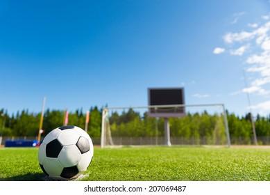 Soccer ball on penalty spot against goal.