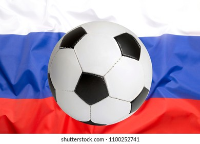 Soccer ball on Russian flag for background