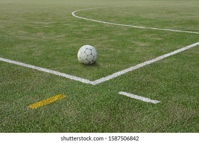 Soccer ball on sports field at boundary line