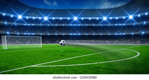 Soccer ball on stadium, arena in night illuminated spotlights