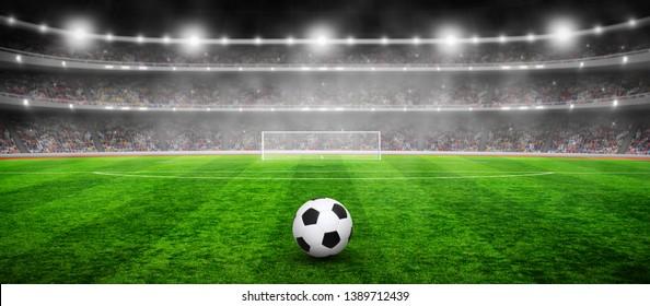 Soccer ball on stadium with illumination, green grass and night sky