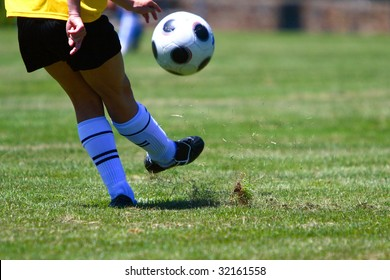 Soccer ball and player on the field.