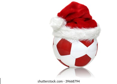 Soccer ball with a Santa hat isolated in white