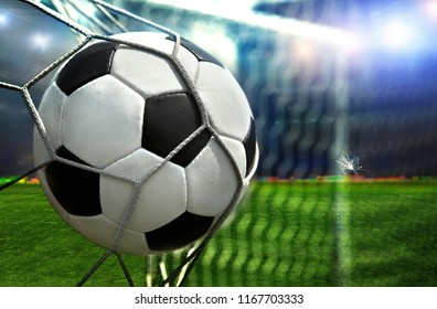 Soccer ball scores in the opponent's goal a football player at the stadium