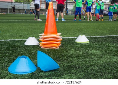 Soccer ball tactics on grass field with cone for training thailand in  background Training children in Soccer academy
