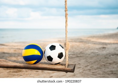 Soccer ball and Volleyball at the beach