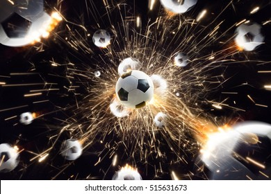 Soccer balls with fire sparks in action black isolate