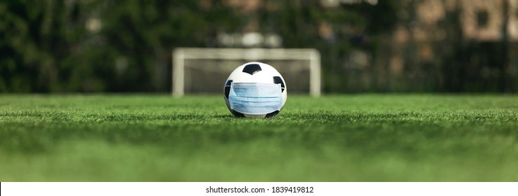 soccer cancellation event concept. Ball with coronavirus mask