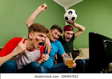 Soccer family, Father and sons cheering in front of TV