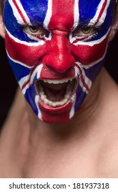 Soccer fan with great britain flag painted over face