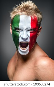 Soccer fan with italian flag painted over face