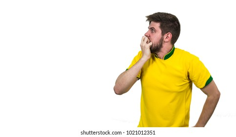 Soccer Fan or tourist with yellow uniform apprehensive on white background