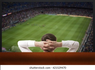 Soccer fan watching the TV