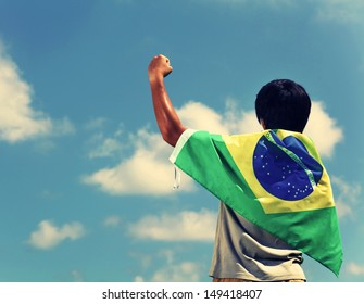 Soccer fans holding brazil flag