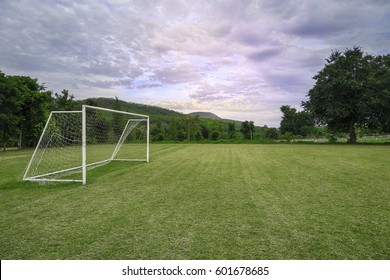 Soccer field with cloudy in the countryside.