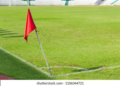 soccer field with corner flag in red