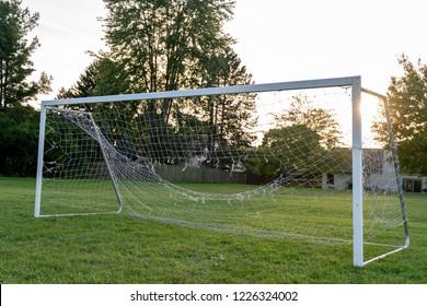 Soccer Field Goal Net In Front of Sun