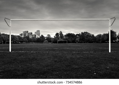 A soccer field in the middle of the city of London.