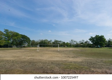 Soccer field and old football goal on the village sports field in summer day., soccer field at urban school. sport concept.