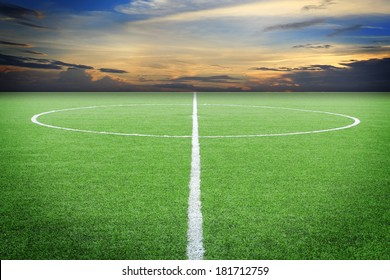 soccer field with sun set