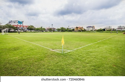 In the soccer field, there will be a flag in the corner of the football.
